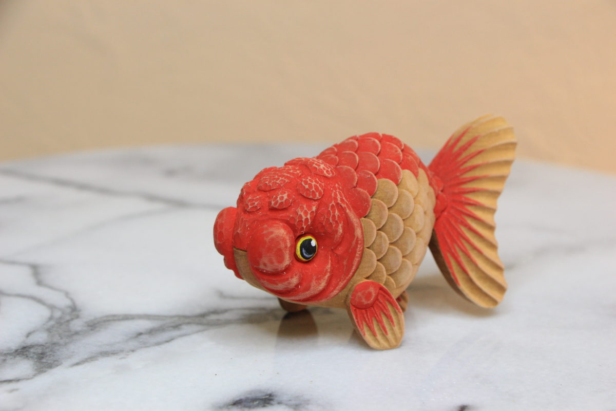 hand carved wooden goldfish